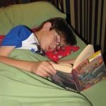 Cam fell asleep reading Harry Potter