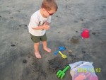 Camden digging on beach