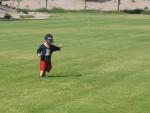 Carsten running through the sprinklers.