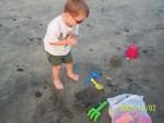 Camden digging on beach